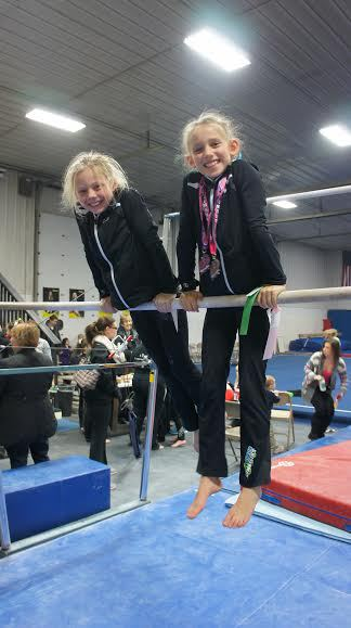 Emily Schulte and Delaney Awe hanging out after a meet